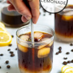 Pinterest Pin showing a glass where lemonade and cold brew coffee are being stirred together
