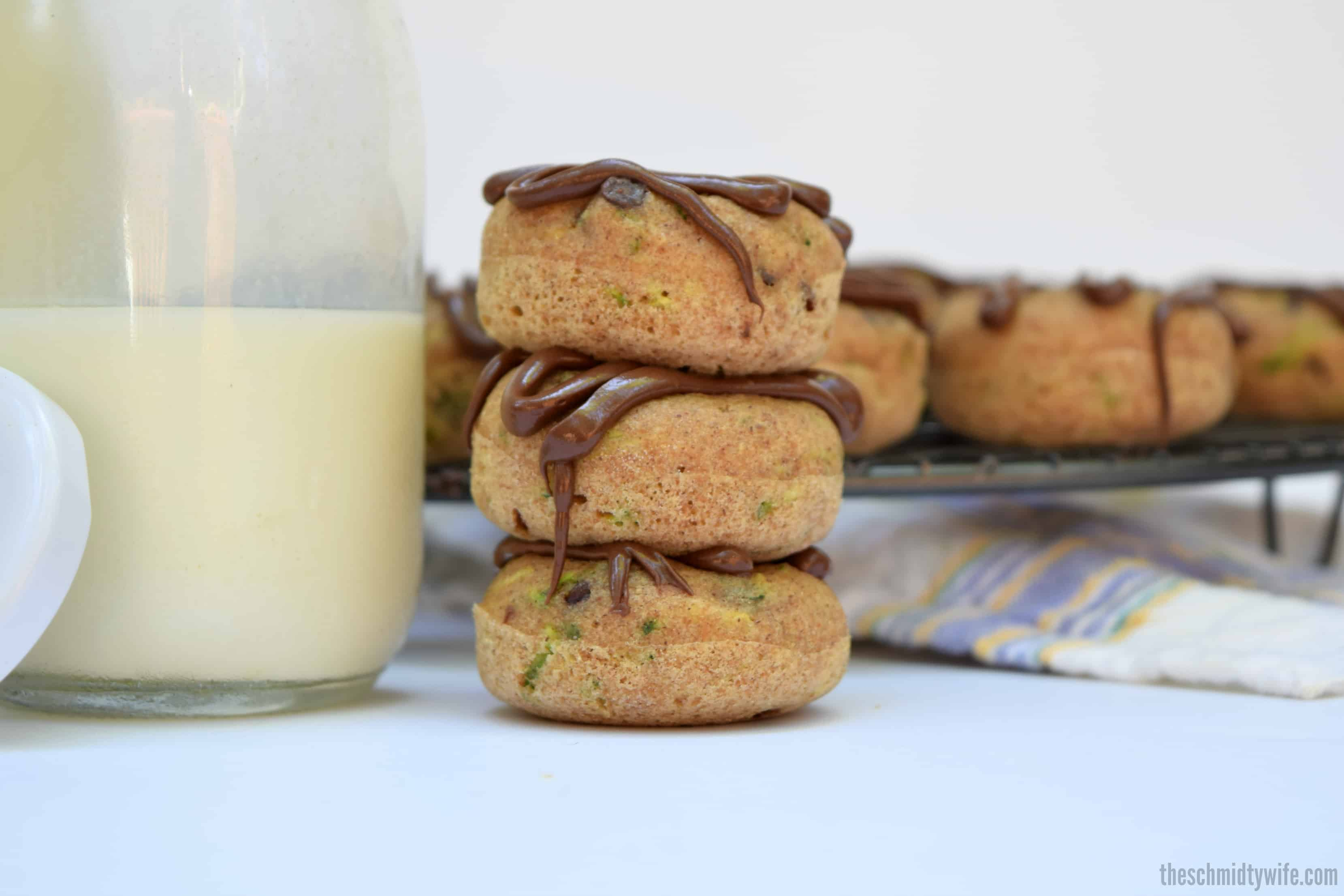 stack of 3 Zucchini Chocolate Chip Baked Donuts with milk
