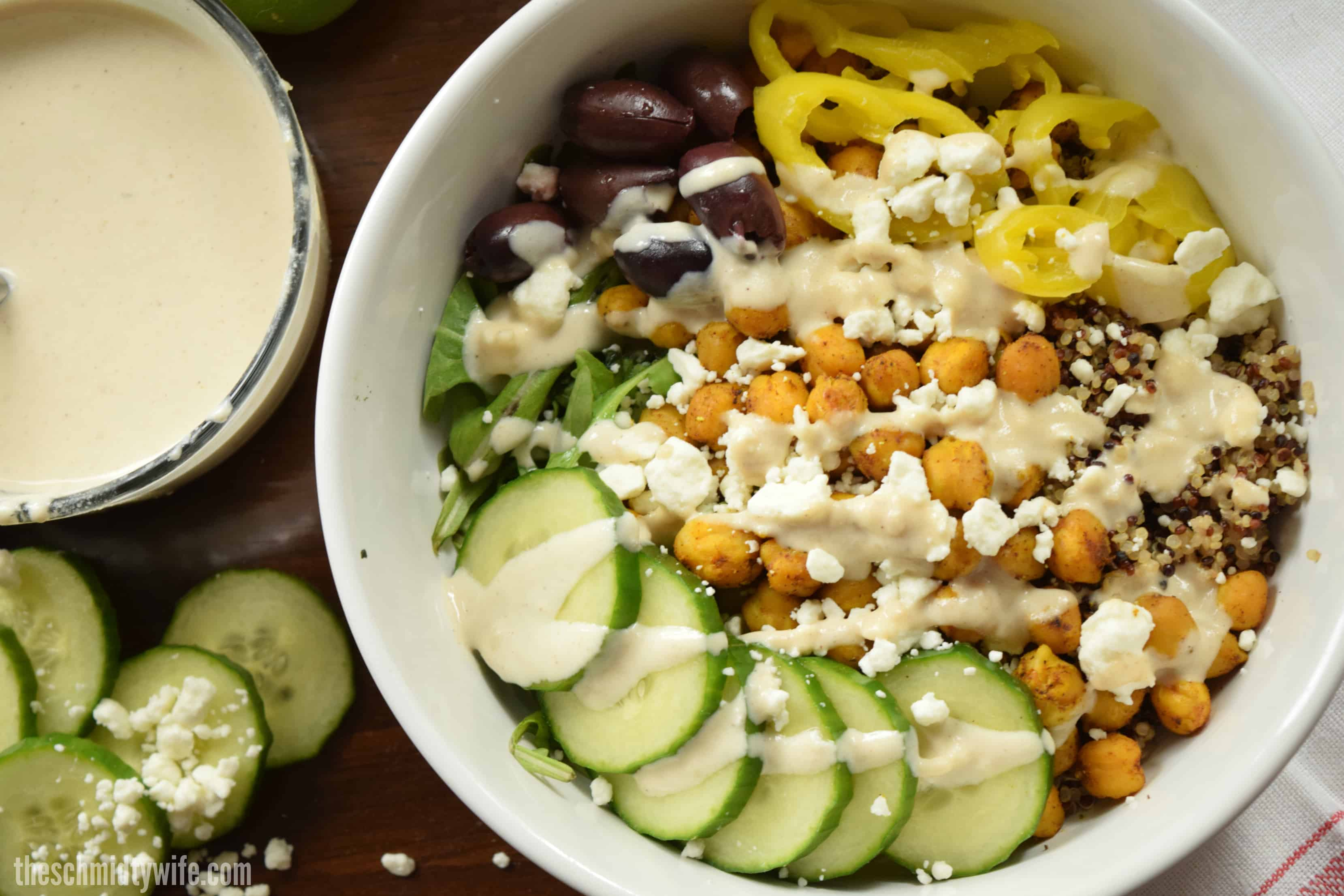large white bowl containing a chickpea shawarma buddha bowl ready to eat