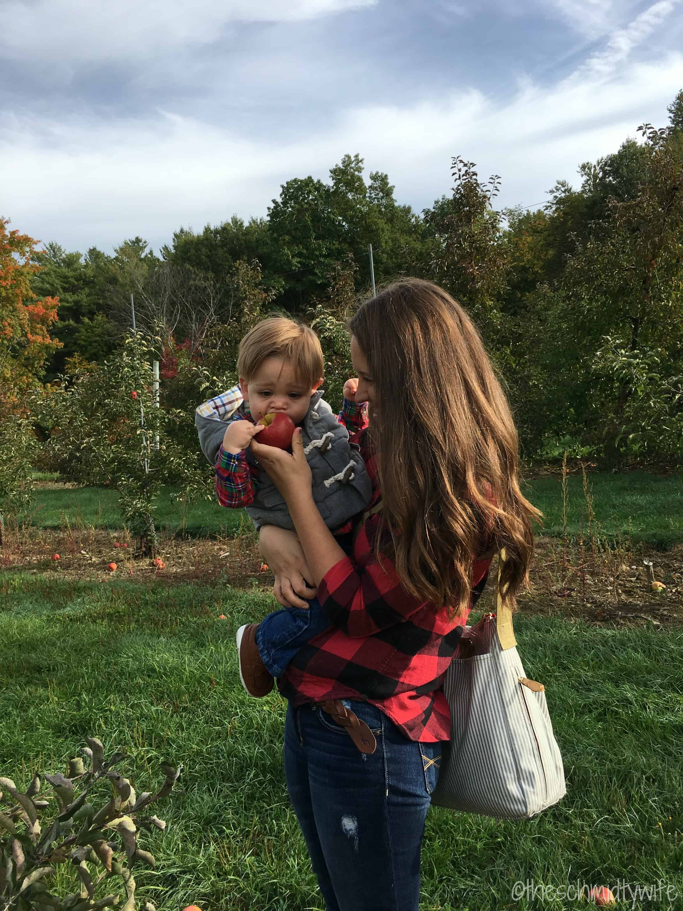 mother and son in apple orchard
