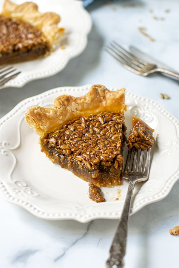 bite of pie on a fork with a slice of pie