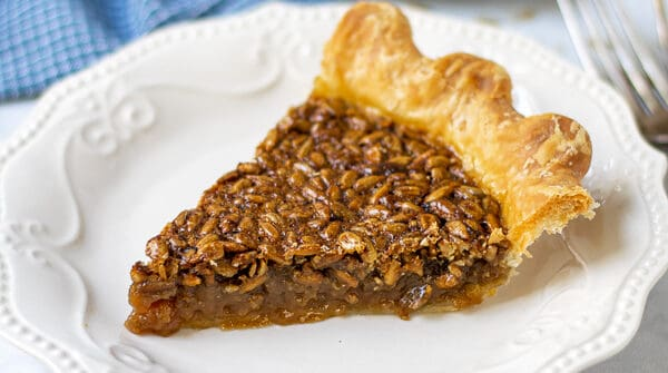 slice of sunflower seed pie on a plate showing off the gooey inside and crunchy top