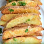 plate full of baked potato wedges