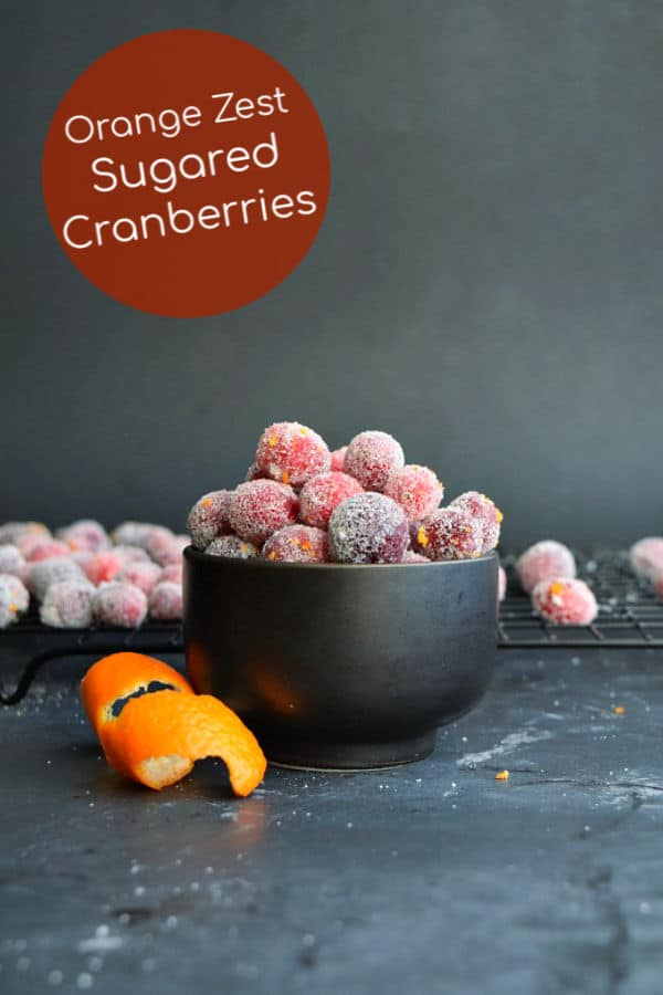 Easy to make homemade sugared cranberries with an orange twist, perfect for holiday snacking and fun dessert accents!