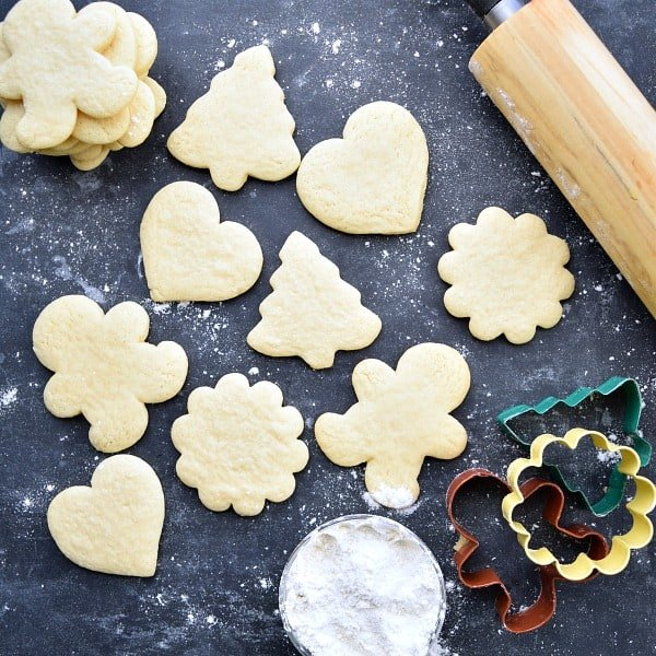 different shaped sugar cookies on a black background
