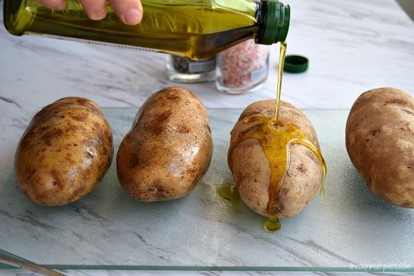 olive oil drizzles on a potato