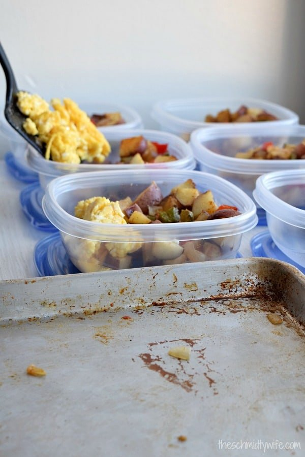 eggs being placed into the meal prep container