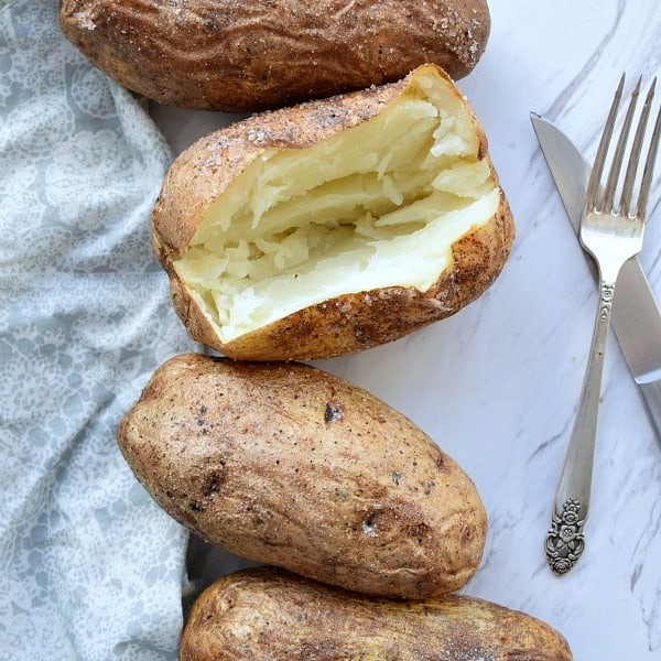 Baked Potato with a slice open showing the white insides