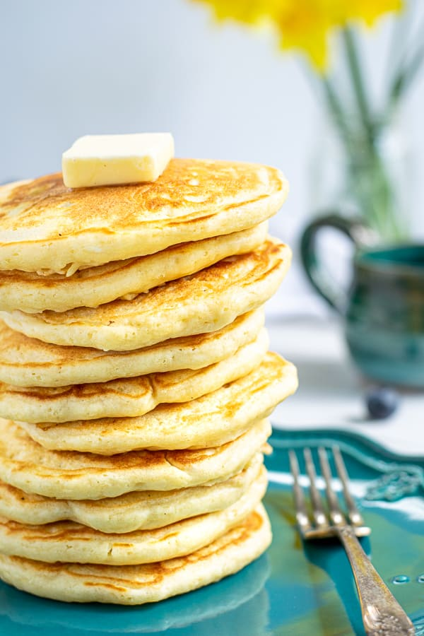 stack of homemade pancakes on a blue plate
