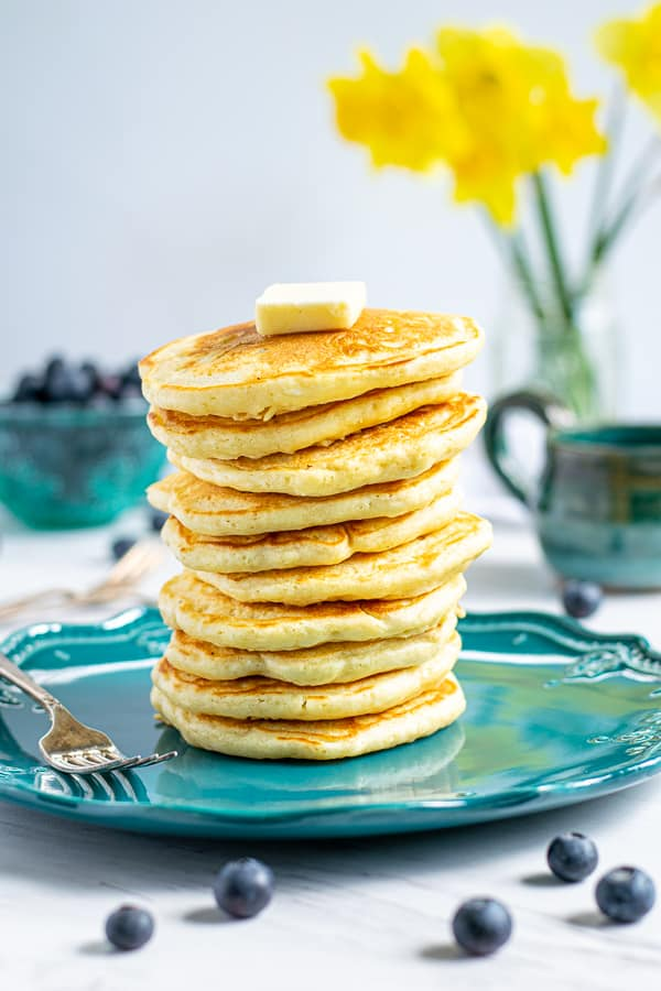 stack of homemade pancakes from scratch on a blue plate