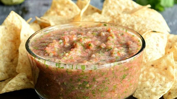Fresh Restaurant Style Salsa in a bowl next to chips and tomatoes