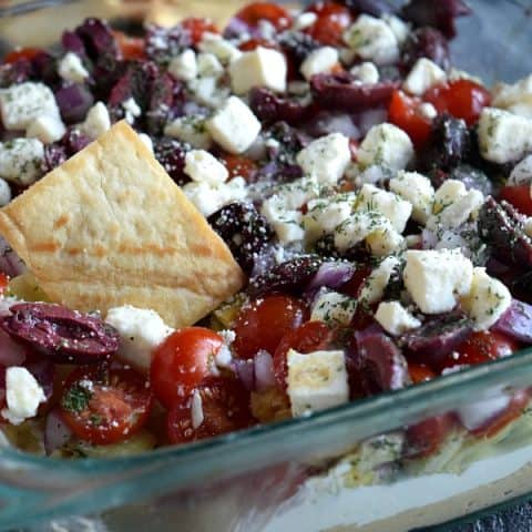Pita Chip dipped into Greek Layer Dip