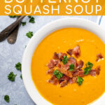 Pinterest Pin with text overlay, Roasted Butternut Squash Soup, image of a large bowl of butternut squash soup garnished with bacon and parsley.