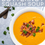 Pinterest Pin with text overlay, Roasted Butternut Squash Soup, image of a white bowl full of yellow soup garnished with bacon.