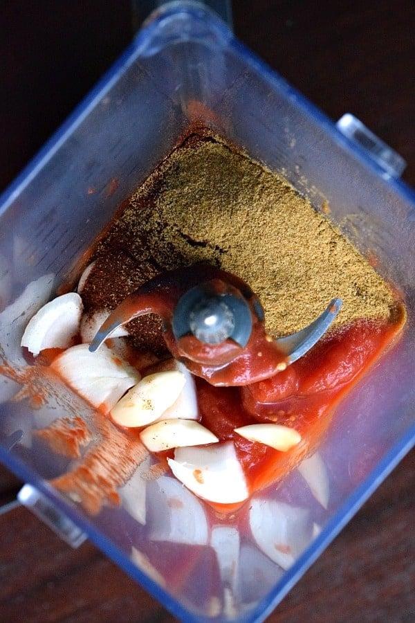 Ingredients for enchilada sauce sitting in blender