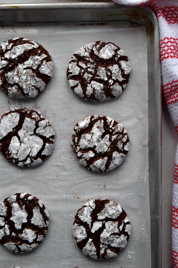 Overhead shot of Chocolate Peppermint Crinkle Cookies on a baking tray