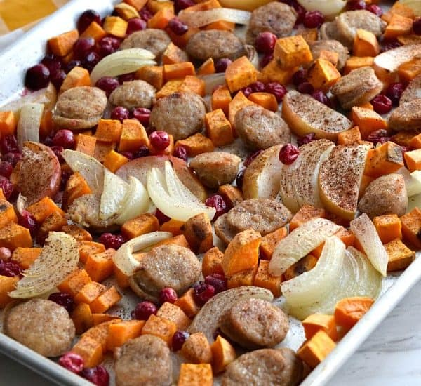 side view of cooked Close up of colorful uncooked Sheet Pan Cranberry Chicken Sausage