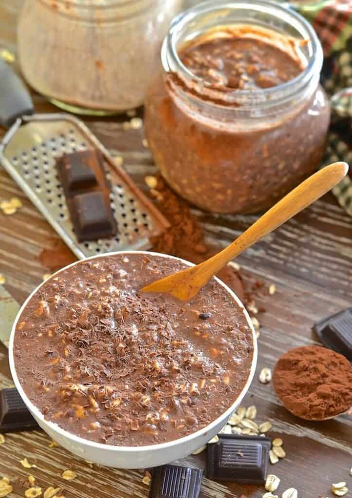 healthy to go ginger chocolate overnight oats in a jar with a spoon