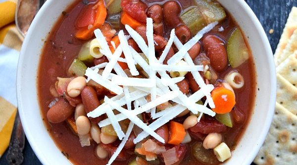 overhead shot of minestrone in a bowl with grated cheese