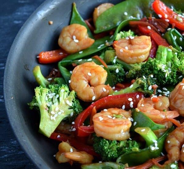 skillet filled with cooked shrimp stir fry
