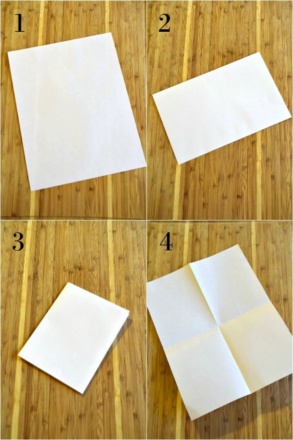 a piece of paper being folded into 4ths