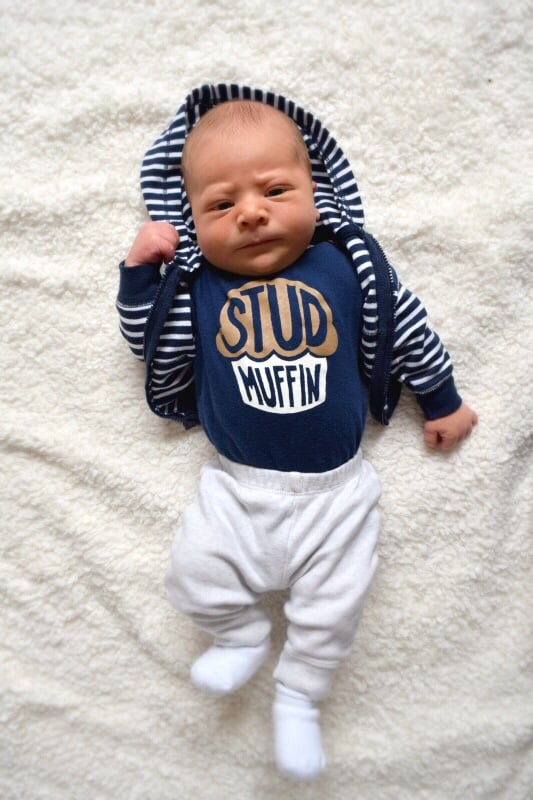 Overhead picture of baby in a 'stud muffin' onesie