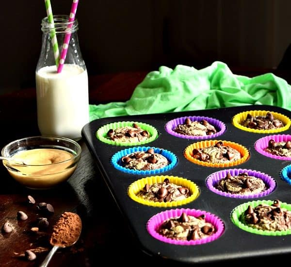 Chocolate Peanut Butter Muffins in a tin with milk on the table