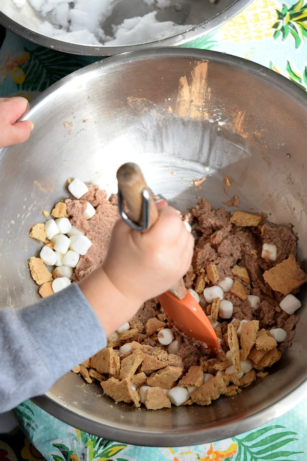 toddler mixing s'more snow ice cream
