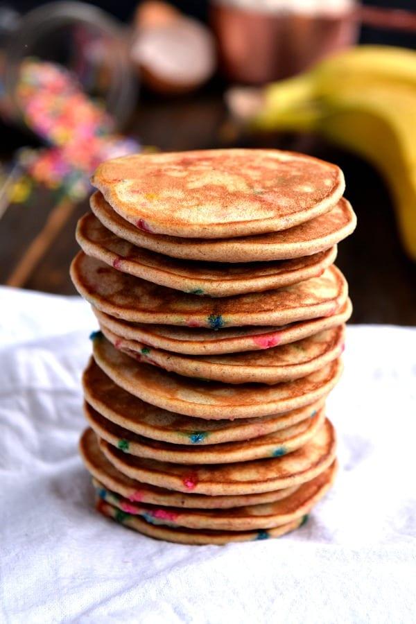 A tall stack of Mini Whole Wheat Banana Pancakes