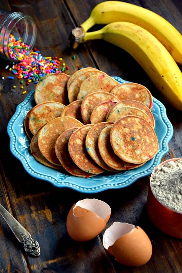 plate full of mini whole wheat banana pancakes