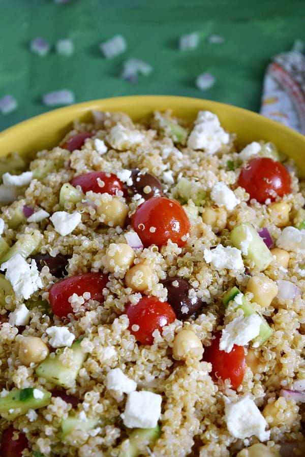 Greek Quinoa Chickpea Salad tossed and topped with feta cheese