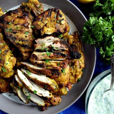 Grilled Chicken Shawarma Sliced on a plate ready to be added to a pita