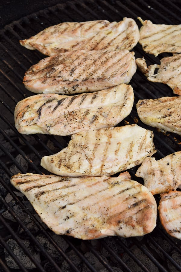 Chicken breasts on a charcoal grill