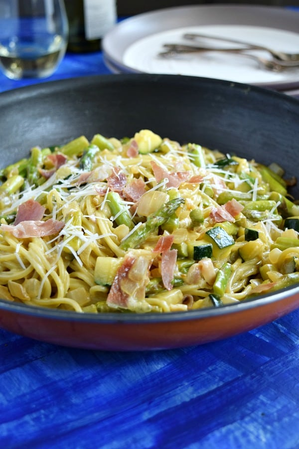 Summer Spaghetti Carbonara in a skillet topped with cheese