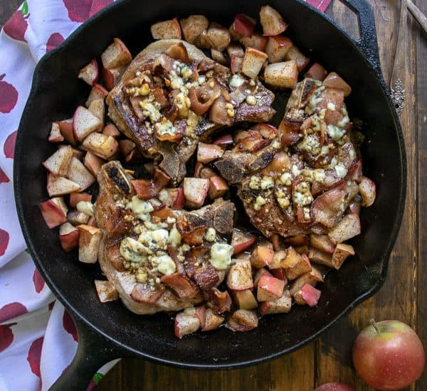 Overhead Shot of Apple Bacon Blue Smothered Pork Chops in a cast iron skillet