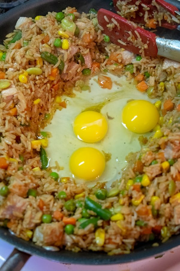 The eggs in the hole to be scrambled into the fried rice