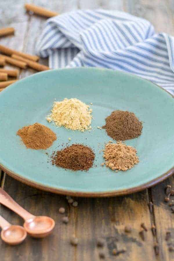 5 spices on a plate to make gingerbread spice