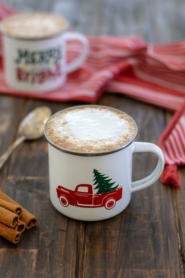 a skinny gingerbread tea latte with foam in a white mug on a table