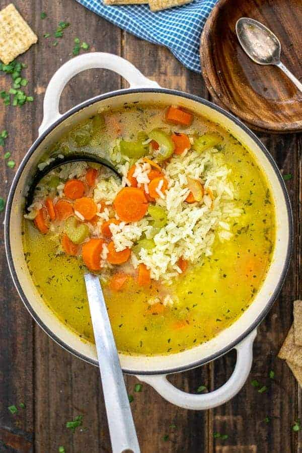 carrots, celery, and rice in a soup pot