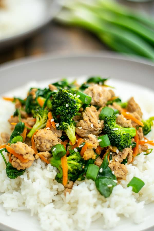 close up of ground pork stir fry on rice