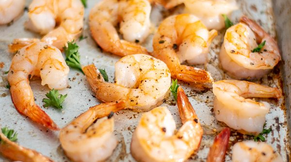 close up of oven baked shrimp recipe on a sheet pan