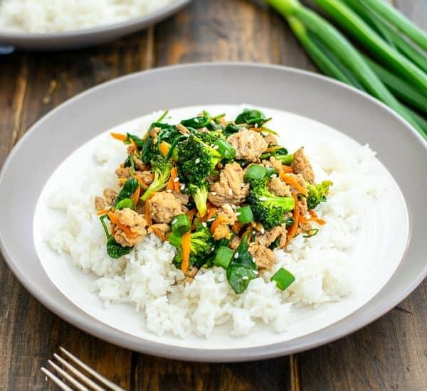plate full of rice and ground pork stir fry