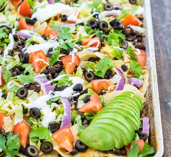 black bean nachos recipe on a sheet pan ready to eat