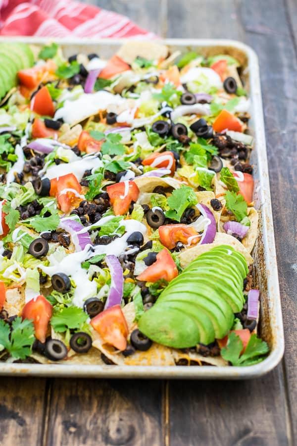 black bean nachos recipe on a sheet pan ready to eat