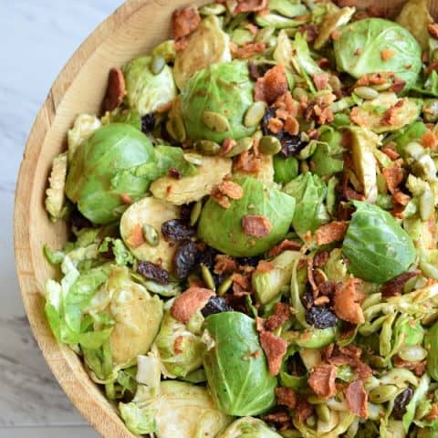 a bowl full of Brussel sprout salad
