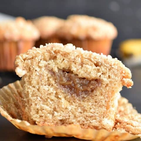 a banana foster filled muffin cut in half to reveal filling