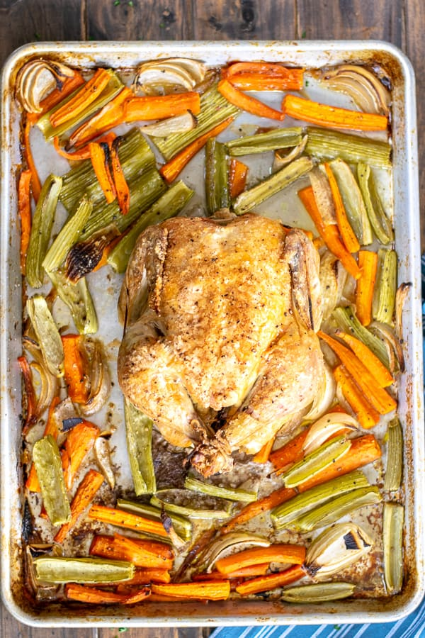 freshly cooked chicken on a sheet pan with vegetables