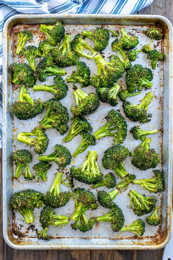 freshly cooked broccoli on a sheet pan - Roasted Broccoli Recipe | Oven Roasted Broccoli Recipe | Best Oven Roasted Broccoli Recipe |Roasted Broccoli Recipes Healthy | Recipe for roasted Broccoli in the Oven