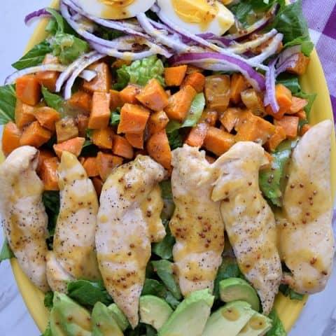 Honey Mustard Chicken and Sweet Potato Salad on a large yellow platter