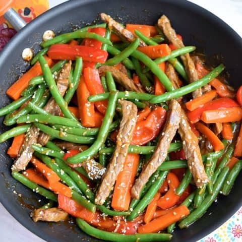 orange-ginger beef stir fry with carrots, red bell pepper, and green beans